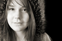 Serious young woman in fur hat Stock Photos