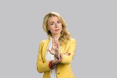 Serious young woman gesturing stop. Stock Photo