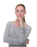 Serious young woman with hand on chin Stock Photography
