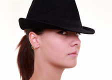 Serious young woman with hat Stock Images