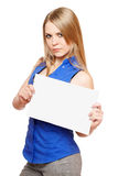 Serious young woman holding empty white board Stock Image