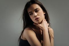 Serious young woman looking down and thinking Royalty Free Stock Photos
