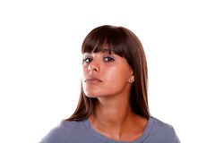Serious young woman looking at you on blue blouse Royalty Free Stock Photos