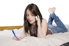 Serious young woman lying Royalty Free Stock Photo