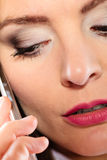 Serious young woman make phone call. Emotions and communication message. Young stressed woman talk make a phone call cell phone argue Stock Image