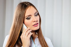 Serious young woman make phone call. Emotions and communication message. Young stressed woman talk make a phone call cell phone argue Stock Photo