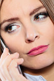 Serious young woman make phone call. Emotions and communication message. Young stressed woman talk make a phone call cell phone argue Royalty Free Stock Image