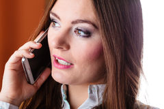 Serious young woman make phone call. Emotions and communication message. Young stressed woman talk make a phone call cell phone argue Royalty Free Stock Photos