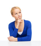 Serious young woman making decisions Royalty Free Stock Photos
