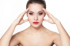 Serious young woman model with glamour red lips Stock Photos