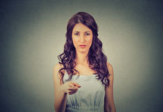 Serious young woman pointing at camera royalty free stock photos