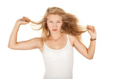 Serious young woman with raised arms Royalty Free Stock Photos