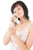 Serious young woman speaking on the phone Stock Photos