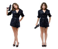 Women with a submachine gun. Serious young woman is standing in two different poses and holding a submachine gun. She is wearing a short dress and high heels Royalty Free Stock Image