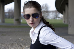 Serious young woman in sunglasses Stock Photos