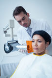 Serious young woman undergoing dental checkup Royalty Free Stock Photos