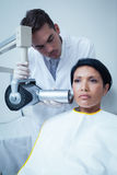 Serious young woman undergoing dental checkup Stock Images