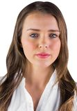 Serious young woman in white shirt Royalty Free Stock Image