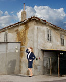 Serious Business Woman in front of Old House-concept. Serious Business Woman in front of Old House is Looking to distance-concept Stock Photography