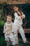 Seriouse small sister and brother looking for you Stock Photo