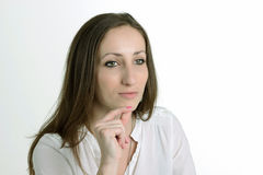 Serious Woman is Having an Idea- on White Background. Serious Woman with Big Green Eyes  is Having an Idea and She is  on White Background Royalty Free Stock Image