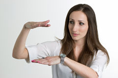 Serious Woman is Showing a Size with Hands Isolated on White Ba. Serious Woman is Showing a Size with Hands  Isolated on White Background Stock Photo