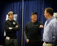 Seriously?. Dave Carraro and Bill Monte appear to be in a disagreement with Kevin Leonowert Stock Photos
