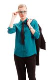 Seriously businesswoman holding jacket Stock Image