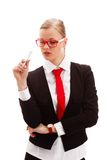 Seriously businesswoman holding pen Stock Photo