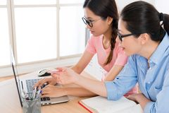 Seriously female student using mobile computer Royalty Free Stock Photos