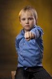 Boy extends a hand in a fist Stock Photos
