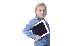 Isolated seriously boy with touch pad Stock Photo
