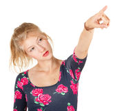Seriously teenage girl pointing up Royalty Free Stock Photo