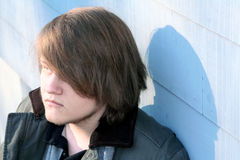 Seriously Thinking. Serious teenage boy in profile outdoors in winter royalty free stock images