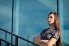 Seriously woman standing on stairway, horizontal Stock Photos