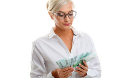 Seriously young woman holding euro bills Stock Images