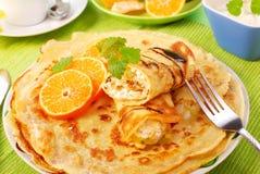 serowi chałupy pomarańcze bliny obrazy stock