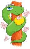 Serpent avec une pomme sur un arbre Images stock