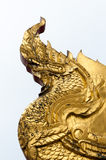 Serpent head. Gold serpent head in the temple Stock Photos