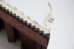 Serpent head. White serpent head in the temple on a white sky Stock Photos
