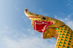 Serpent king or king of naga statue in thai temple on blue sky b Royalty Free Stock Photo