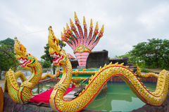 Serpent. King or king of naga statue in thai temple on blue sky background Royalty Free Stock Photo