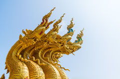 Serpent king or king of naga statue in thai temple on blue sky background Stock Photography