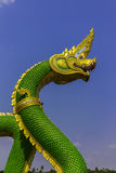 Serpent king or king of naga statue in thai temple on blue sky background Stock Images