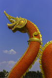 Serpent king or king of naga statue in thai temple on blue sky background Royalty Free Stock Image