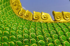 Serpent king or king of naga statue in thai temple on blue sky background Stock Image