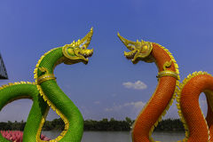 Serpent king or king of naga statue in thai temple on blue sky background Royalty Free Stock Photos