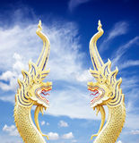 Serpent king of nagas statue on blue sky Royalty Free Stock Photography
