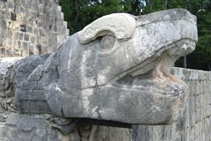 Serpent sculpture at The Great Ballcourt in Chichen Itza, Yucatan, Mexico Royalty Free Stock Images