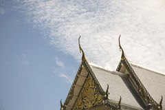 Serpent sculpture of temple roof in Thailand. Royalty Free Stock Images
